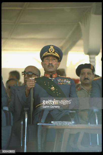 Egyptian President Anwar Sadat watching army parade of weaponst