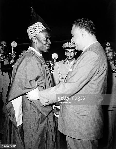 Egyptian president Gamal Abdel Nasser welcomes Prime Minister of Nigeria Abubakar Tafawa Balewa for the OAU summit from 17 to 21 July in Cairo