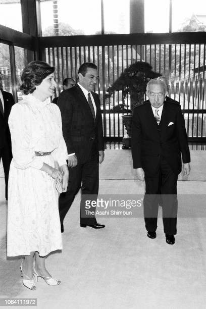 Egyptian President Hosni Mubarak and his wife Suzanne are escorted by Emperor Hirohito prior to their meeting at the Imperial Palace on April 6, 1983...