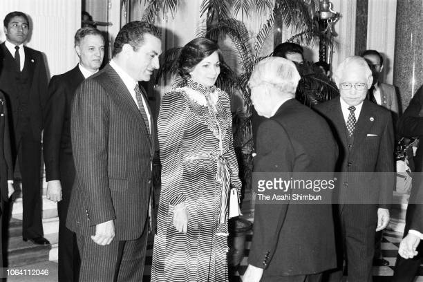 Egyptian President Hosni Mubarak and his wife Suzanne are greeted by Emperor Hirohito prior to their welcome ceremony at the Akasaka State Guest...