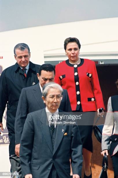 Egyptian President Hosni Mubarak and his wife Suzanne are seen on arrival at Haneda International Airport on March 13, 1995 in Tokyo, Japan.