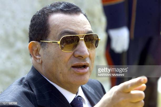 Egyptian President Hosni Mubarak gestures as he talks to reporters after laying the foundation stone of Egypt's new museum 04 February 2002. Mubarak...