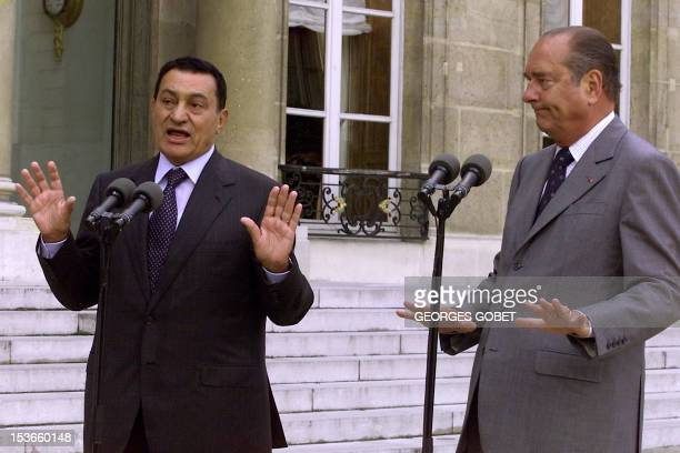 Egyptian President Hosni Mubarak gestures during a joint press conference with French President Jacques Chirac after their meeting at the Elysee...