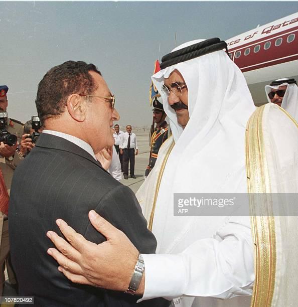Egyptian President Hosni Mubarak greets Qatari leader Sheikh Hamad bin Khalifa alThani at Cairo airport 16 August 2000 Sheikh Hamad whose country...