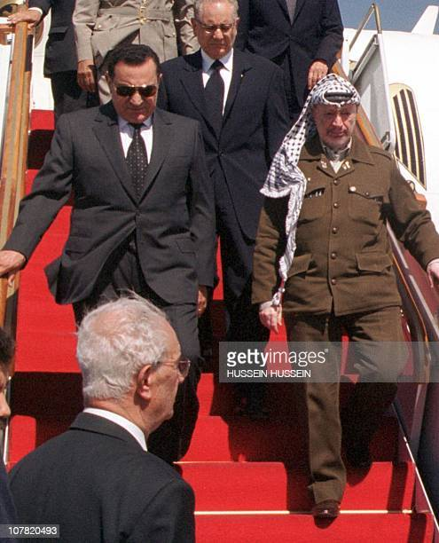 Egyptian President Hosni Mubarak, left, and Palestinian Leader Yasser Arafat, arrive at Damascus International Airport to pay their last respects to...