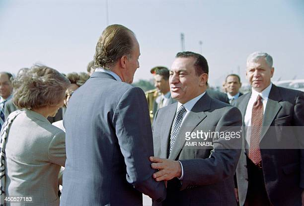Egyptian President Hosni Mubarak shakes hands with King Juan Carlos of Spain accompanied by Queen Sofia in Cairo on February 18 1997 Spanish King...