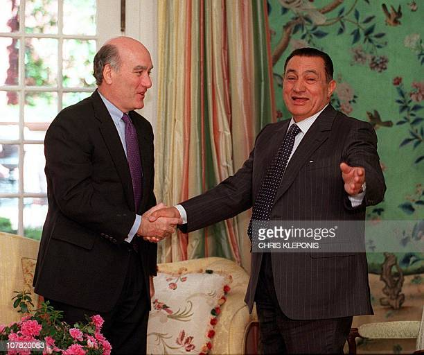 Egyptian President Hosni Mubarak shakes hands with US Secretary of Commerce William Daley during a meeting at Blair House in Washington DC 26 March...