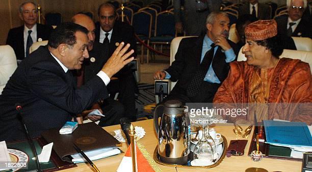 Egyptian President Hosni Mubarak speaks with Libyan Leader Moammar Ghadafi during a break at the Arab summit March 1 2003 in Sharm elSheikh Egypt The...