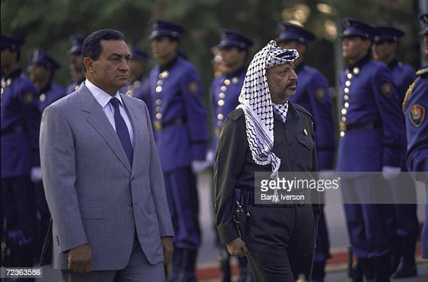 Egyptian President Hosni Mubarak with PLO leader Yasser Arafat.
