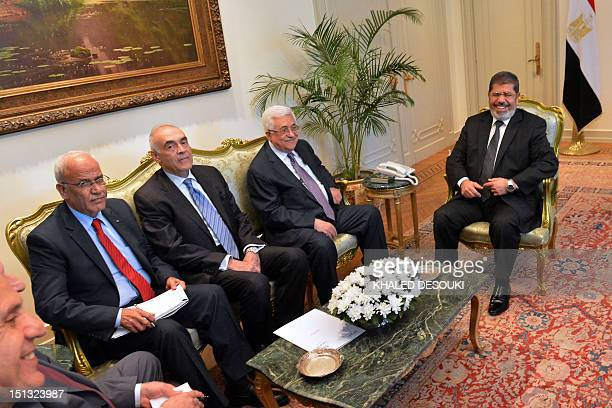 Egyptian President Mohamed Morsi and Foreign Minister Mohammed Kamel Amr meet with Palestinian president Mahmud Abbas and chief negotiator Saeb...