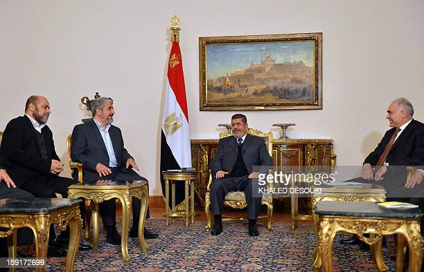 Egyptian President Mohamed Morsi and his Foreign Minister Mohamed Kamel Amr meet with Hamas leader Khaled Meshaal and Hamas political bureau member...
