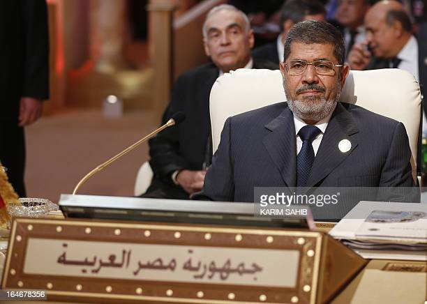 Egyptian President Mohamed Morsi attends the opening of the Arab League summit in the Qatari capital Doha on March 26 2013 The Arab League kicked off...