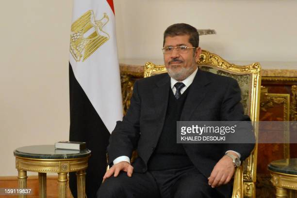 Egyptian President Mohamed Morsi is seen during his meeting and Qatari Prime Minister and Foreign Minister Hamad bin Jassim Al-Thani in Cairo on...