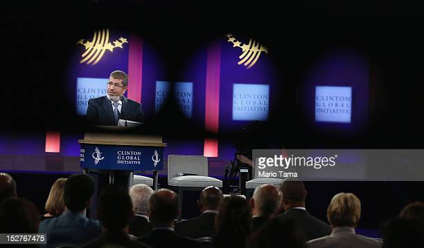 Egyptian President Mohamed Morsi is seen through a camera crane arm while speaking at the Clinton Global Initiative meeting on September 25 2012 in...