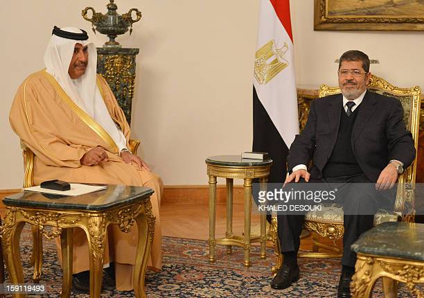 Egyptian President Mohamed Morsi meets with Qatari Prime Minister and Foreign Minister Hamad bin Jassim Al-Thani in Cairo on January 8, 2013. Qatar...