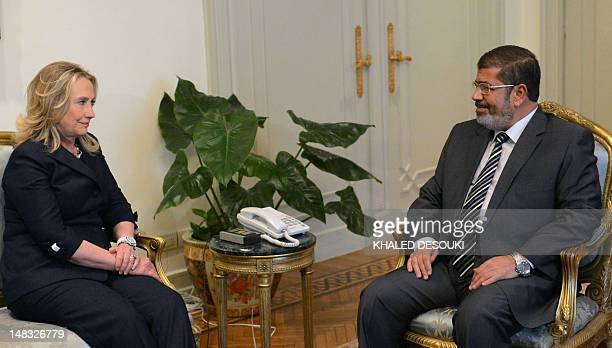 Egyptian President Mohamed Morsi meets with US Secretary of State Hillary Clinton at presidential palace in Cairo on July 14, 2012. Clinton arrived...