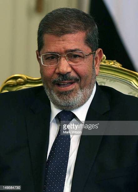 Egyptian President Mohamed Morsi participates in a meeting US Secretary of Defense Leon Panetta at the Presidential Palace on July 31 2012 in Cairo...