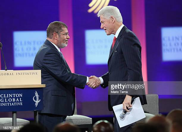 Egyptian President Mohamed Morsi shakes hands with former U.S. President Bill Clinton at the Clinton Global Initiative meeting on September 25, 2012...