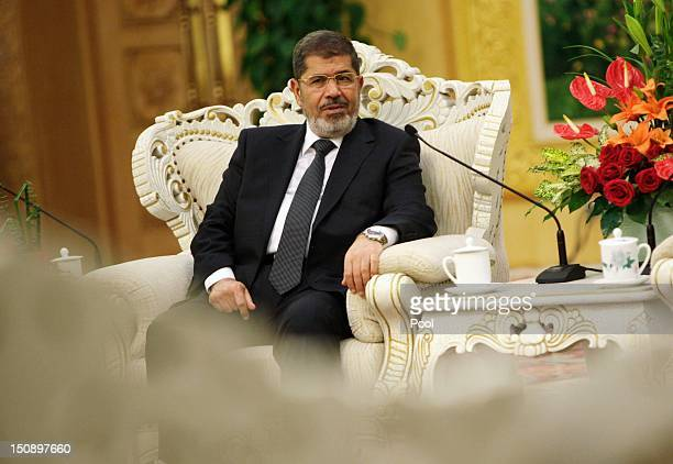 Egyptian President Mohamed Morsi speaks to Chinese Vice-President Xi Jinping during their meeting in the Great Hall of the People on August 29, 2012...