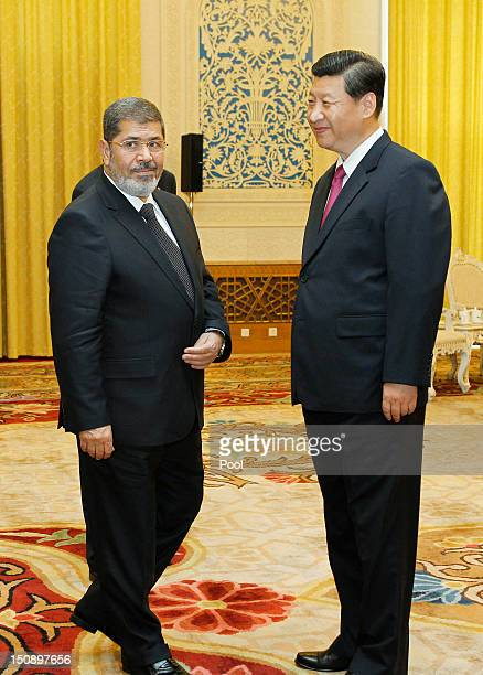 Egyptian President Mohamed Morsi stands with Chinese Vice-President Xi Jinping during their meeting in the Great Hall of the People on August 29,...