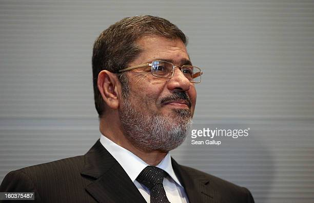 Egyptian President Mohamed Mursi arrives to meet with Bundestag President Norbert Lammert following a brief tour of the Reichstag on January 30, 2013...