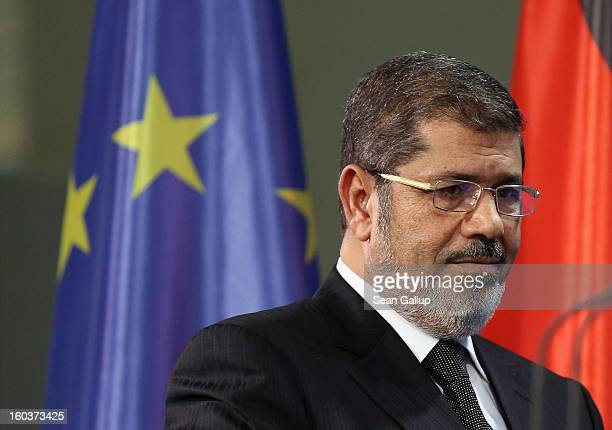 Egyptian President Mohamed Mursi arrives to speak to the media with German Chancellor Angela Merkel following talks at the Chancellery on January 30,...