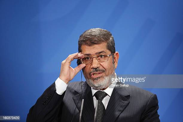 Egyptian President Mohamed Mursi speaks to the media with German Chancellor Angela Merkel following talks at the Chancellery on January 30 2013 in...