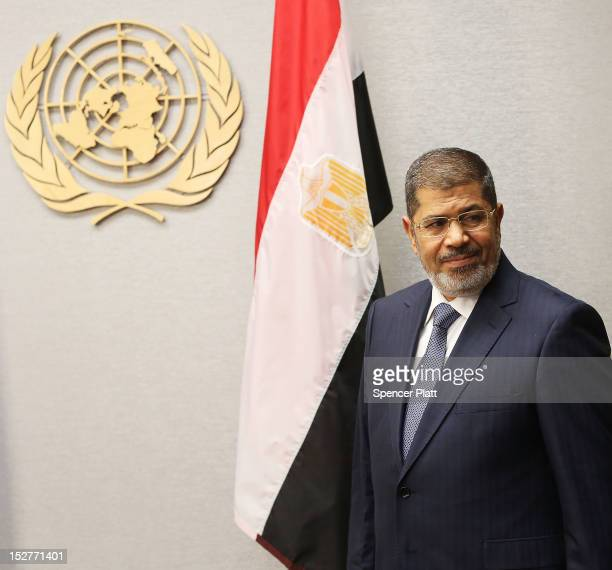 Egyptian President Mohamed Mursi walks into a meeting with United Nations Secretary-General Ban Ki-moon at the United Nations during a meeting at the...