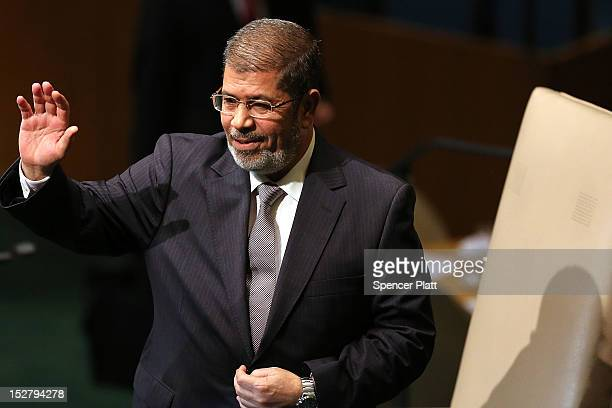Egyptian President Mohammed Morsi walks to the podium for his address to world leaders at the United Nations General Assembly on September 26, 2012...
