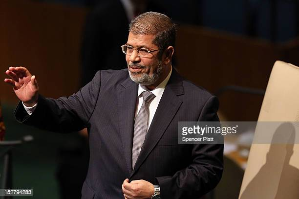 Egyptian President Mohammed Morsi walks to the podium for his address to world leaders at the United Nations General Assembly on September 26 2012 in...