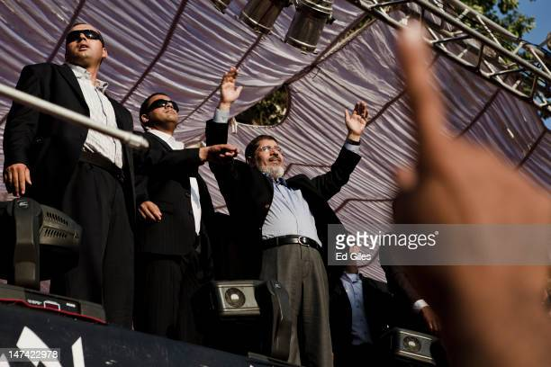 Egyptian Presidentelect Mohamed Morsi arrives on stage in Tahrir Square on June 29 2012 in Cairo Egypt Accompanied by Egypt's 'Presidential Guard'...