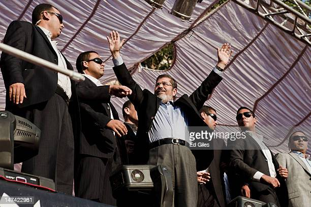 Egyptian President-elect Mohamed Morsi arrives on stage in Tahrir Square on June 29 in Cairo, Egypt. Accompanied by Egypt's 'Presidential Guard',...