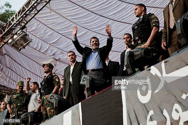 Egyptian President-elect Mohamed Morsi speaks on stage in Tahrir Square on June 29 in Cairo, Egypt. Accompanied by Egypt's 'Presidential Guard',...