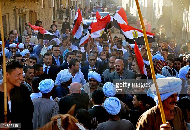 Egyptian presidential candidate and former Arab League chief Amr Mussa is greeted by supporters during a campaign rally in the southern city of Qena...