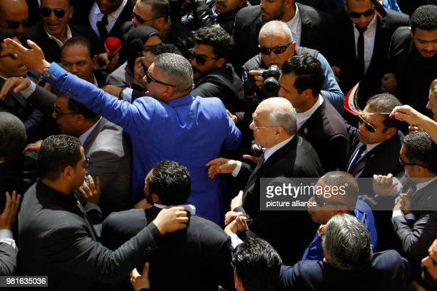 Egyptian Presidential candidate and leader of ElGhad Party Moussa Mostafa Moussa arrives to cast his vote at a polling station on the 1st day of the...