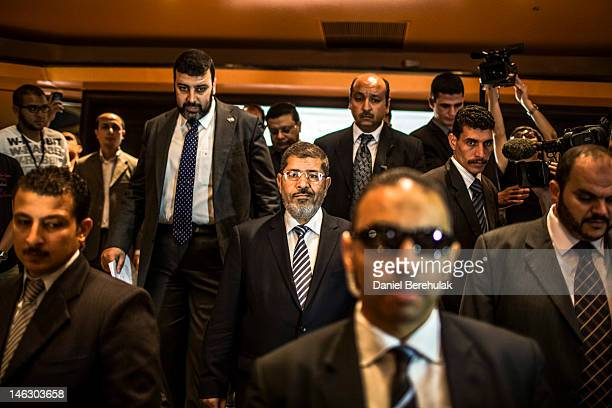 Egyptian presidential candidate Mohamed Morsi of the Muslim Brotherhood arrives to speak at a press conference on June 13 2012 in Cairo Egypt...