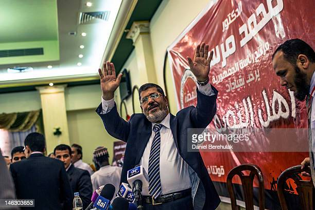 Egyptian presidential candidate Mohamed Morsi of the Muslim Brotherhood addresses suporters at a press conference on June 13 2012 in Cairo Egypt...