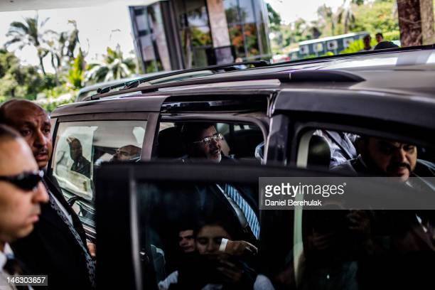 Egyptian presidential candidate Mohamed Morsi of the Muslim Brotherhood departs after speaking at a press conference on June 13 2012 in Cairo Egypt...