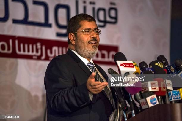 Egyptian presidential candidate Mohamed Morsi of the Muslim Brotherhood speaks at a press conference on June 13 2012 in Cairo Egypt Egyptian...