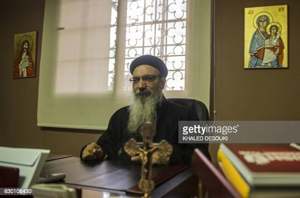 Egyptian priest and Coptic Orthodox Church spokesperson Boulos Halim gives an interview with AFP at his office in the Cathedral in Cairo's Abassiya...