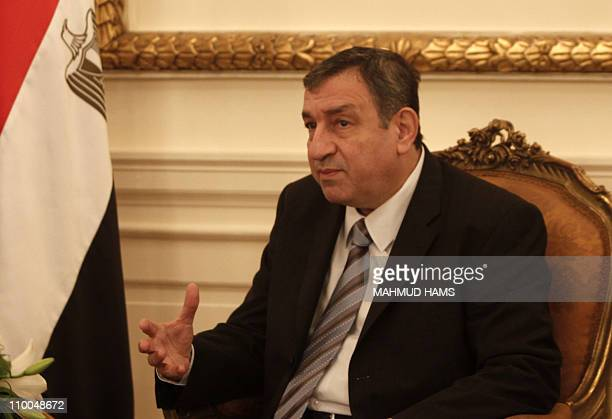 Egyptian Prime Minister Essam Sharaf speaks with EU foreign policy chief Catherine Ashton during a meeting in Cairo on March 14 2011 AFP PHOTO/MAHMUD...