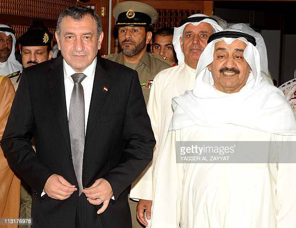 Egyptian Prime Minister Essam Sharaf walks with Kuwaiti Parliament Speaker Jassem alKhorafi as they arrive at the Kuwait National Assembly in Kuwait...