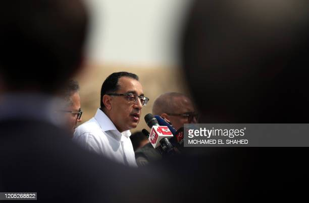 Egyptian Prime Minister Mostafa Madbouli holds a press conference in front of the step pyramid of Djoser in Egypt's Saqqara necropolis, south of the...