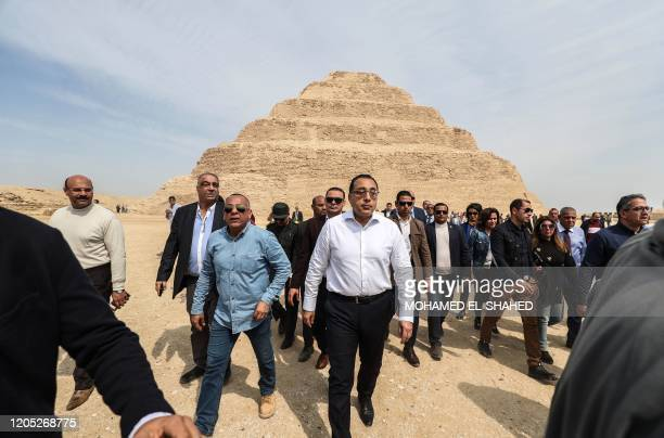 Egyptian Prime Minister Mostafa Madbouli leaves after a press conference in front of the step pyramid of Djoser in Egypt's Saqqara necropolis south...