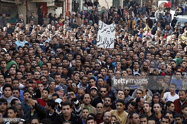 Egyptian protesters and fans of alMasry football club take part in a demonstration in front of the prison in the Egyptian Suez Canal city of Port...
