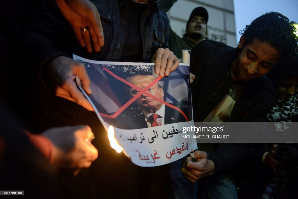 Egyptian protesters burn a portrait of US President Donald Trump during a demonstration against the US president's recognition of Jerusalem as Israel's capital, on December 7, 2017, outside the Syndicate of Journalists Cairo's downtown district. /