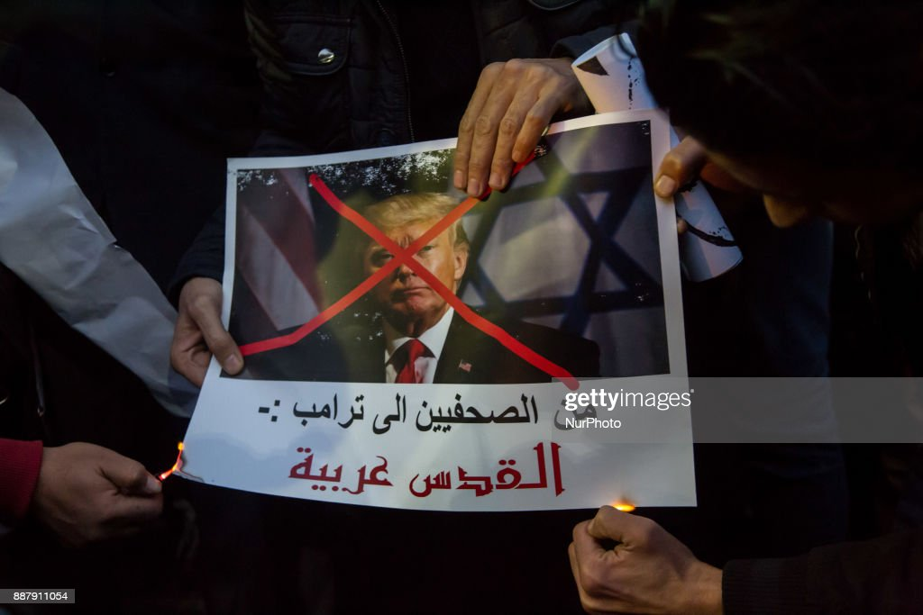 Egyptian protesters burn a portrait of US President Donald Trump during a demonstration against the US president's recognition of Jerusalem as Israel's capital, on December 7, 2017, outside the Syndicate of Journalists Cairo's downtown district.