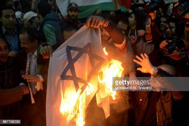 Egyptian protesters burn an Israeli flag during a demonstration against the US president's recognition of Jerusalem as Israel's capital on December 7...