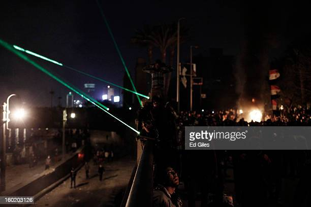 Egyptian protesters gather together during clashes with riot police near Tahrir Square on January 27 2013 in Cairo Egypt Violent protests continued...