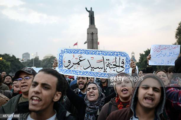 Egyptian protesters hold a placard that reads in Arabic 'In heaven Sayed Amr' in reference to one of the victims of clashes with security forces...
